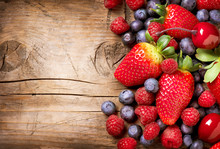 Berries On Wooden Background. ...