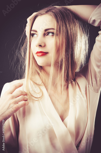 Fotografie, Obraz  Beautiful woman in chiffon beige blouse
