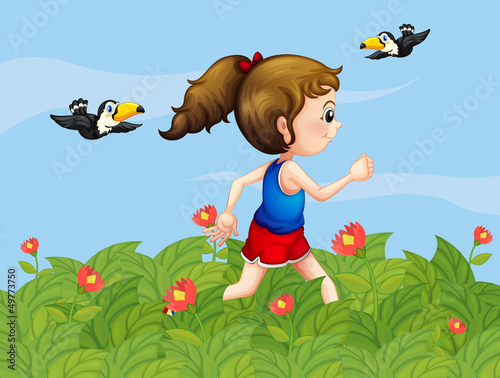 Wall Murals Birds, bees A girl walking at the garden with birds