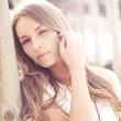 Leinwanddruck Bild - portrait of a beautiful blonde close-up in sunny weather