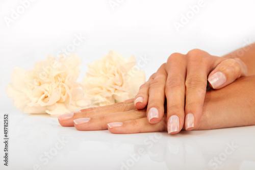 Staande foto Manicure Woman in a nail salon receiving a manicure