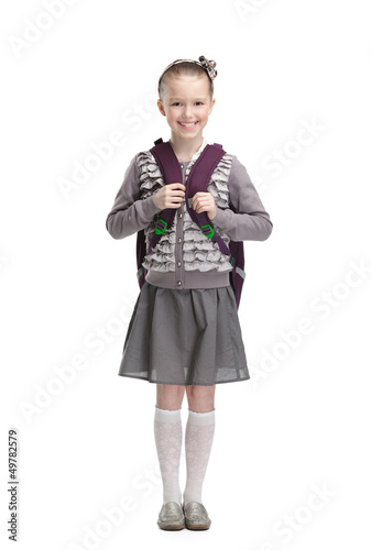 Photo  Smart pupil is ready to go to school, isolated
