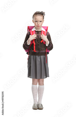 Photo  Frowning pupil is ready to go to school, isolated