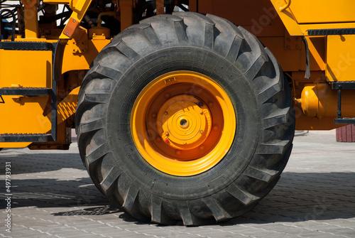 Deurstickers Oude auto s big wheel on yellow tractor