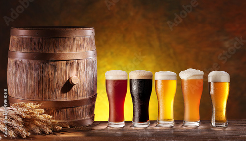 Beer glasses with a wooden barrel. - 49800401