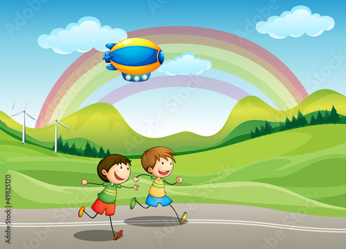 In de dag Regenboog Kids running with an airship above
