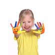 Leinwandbild Motiv kleines Mädchen mit bemalten Händen