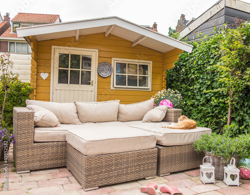 Garden shed and sofa Fototapeta