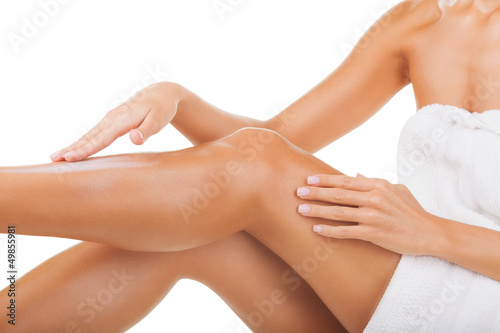 Fotografie, Obraz  Applying moisturizer cream