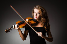 Woman Performer With Violin In...