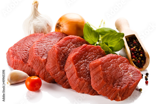 Photo Stands Meat Raw beef and vegetables on white background