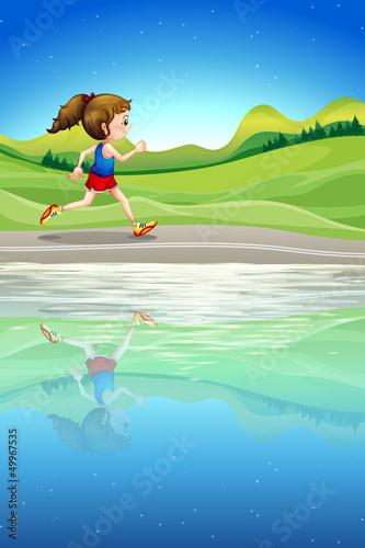 Canvas Prints River, lake A girl running along the river