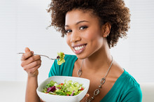 African American Woman Eating ...