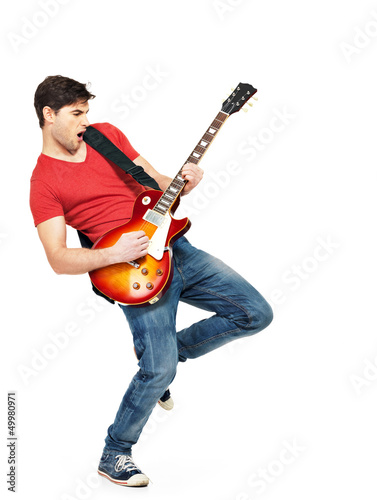Photo  Young guitarist plays on the electric guitar
