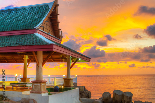 Valokuva  Oriental Thai architecture on the beach at sunset