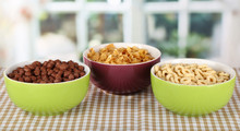 Delicious And Healthy Cereal In Bowls On Table In Room