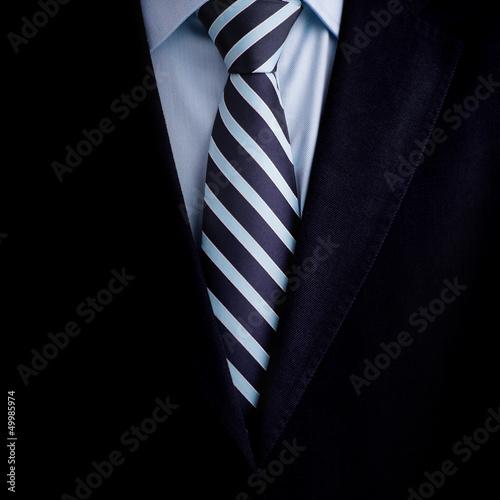 Fototapeta Black business suit with a tie background obraz