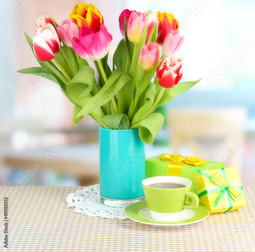 Wall Murals Tulip Beautiful tulips in bucket with gifts and cup of tea