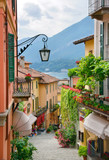 Fototapeta Alley - Picturesque small town street view in Lake Como Italy