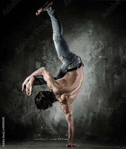 Young b-boy man with naked torso doing brake dancing movements - 49995991