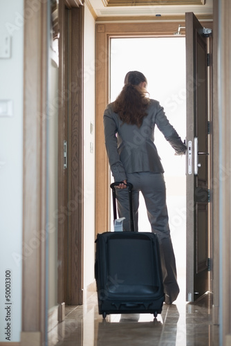 Business woman exiting hotel room . rear view Wall mural