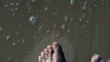 Mans Foot Walking On The Beach, High Eagle, Slow Motion Shot At