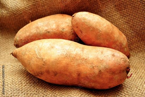 Fotografie, Obraz  Three Sweet Potatoes on Burlap