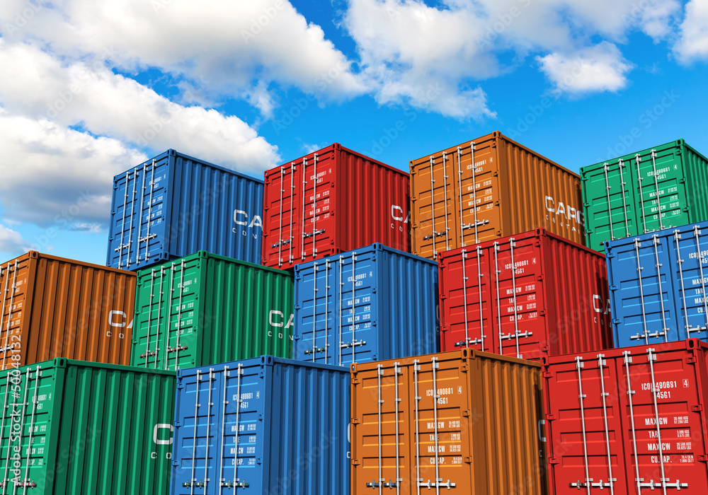 Fototapeta Stacked cargo containers in port