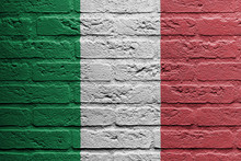 Brick Wall With A Painting Of A Flag, Italy