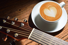Latte Art And Guitar On Wooden Table