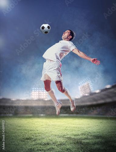 Foto auf AluDibond Fußball football player striking the ball