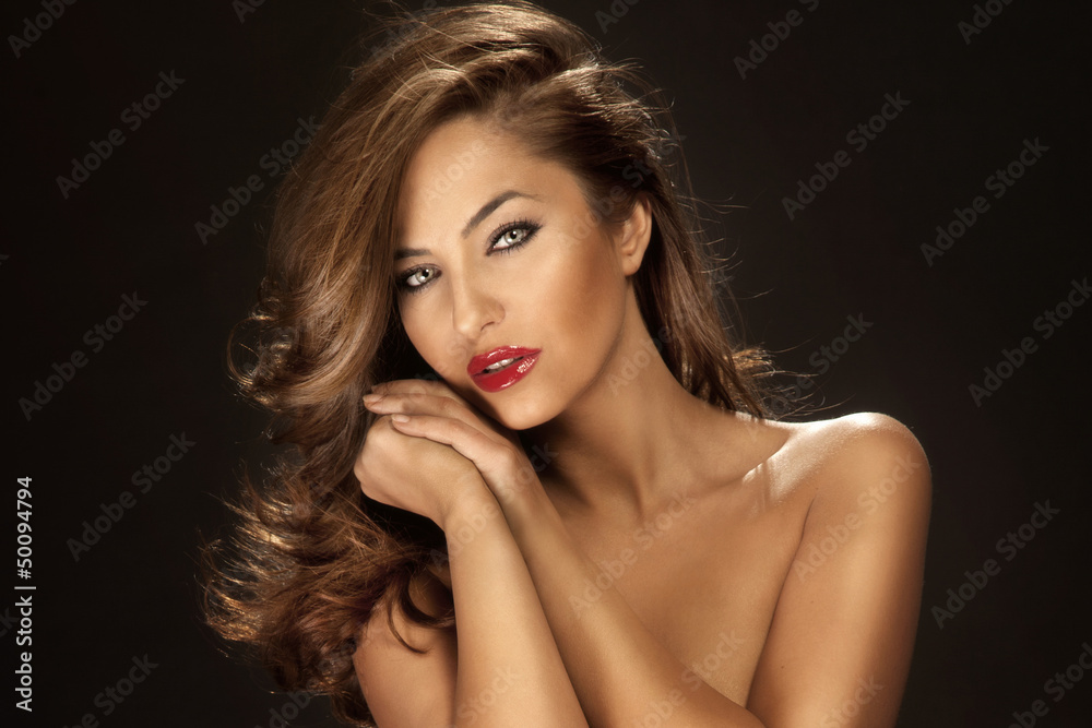 Fototapety, obrazy: Portrait of attractive woman with red lips and long curly hair