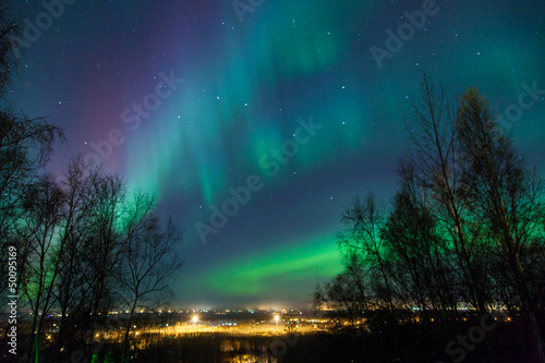 Aluminium Prints Green blue Northern Lights over City