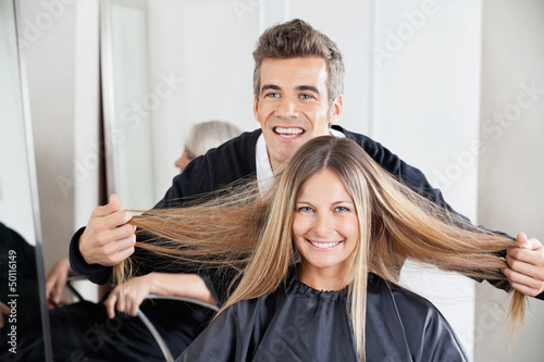 Hairdresser Examining Customer's Hair St Salon - 50116149