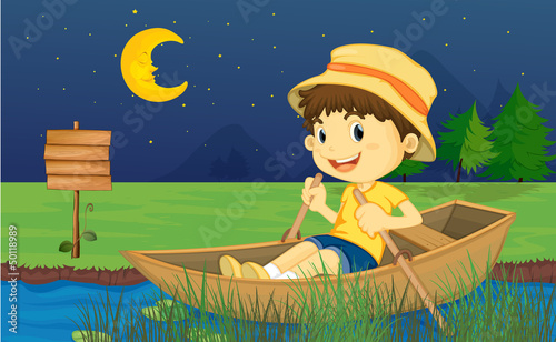 Canvas Prints River, lake A boy riding in a boat