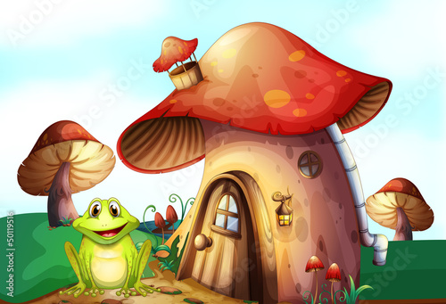 Photo Stands Magic world A green frog near a mushroom house