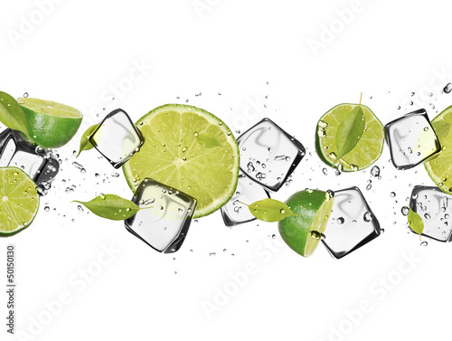 Foto op Plexiglas In het ijs Limes with ice cubes, isolated on white background