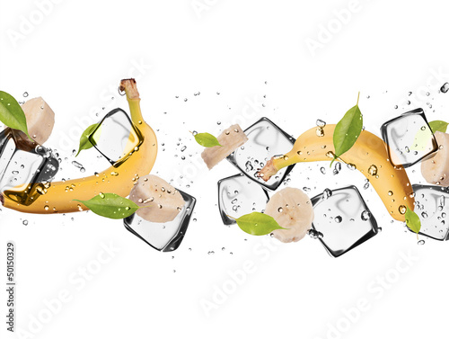 Poster Dans la glace Banana with ice cubes, isolated on white background