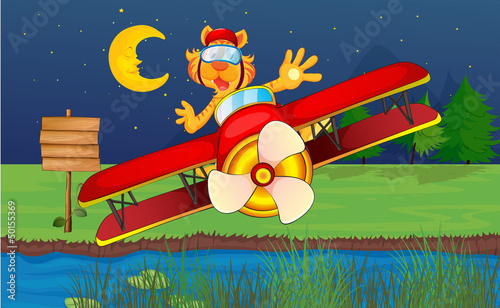 Papiers peints Avion, ballon A tiger riding in a red plane