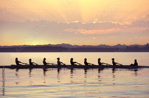 Team rowing boat in bay #50174327