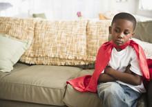 Pouting Black Boy In Superhero Cape