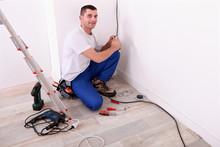 Tradesman Installing Electrica...