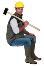 Man With Sledge-hammer Sat On ...