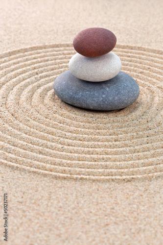 Tuinposter Stenen in het Zand Three pebble stack zen garden