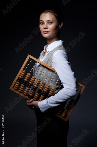 Accountant with old-fashioned adding machine - 50248996