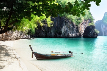 Fototapeta na wymiar boat on beach of island in Krabi Province, Thailand
