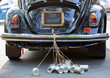 canvas print picture - Rear view of a vintage car with just married sign and cans attac