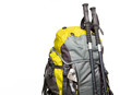 Top of packed backpack and trekking poles on white background