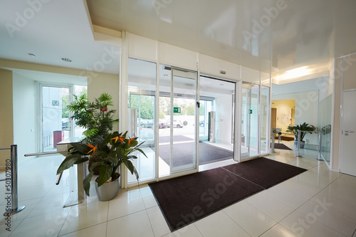 Fototapeta Entrance to administrative building equipped with automatic door obraz