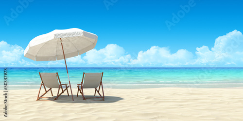 Fotografia  Chaise lounge and umbrella on sand beach.